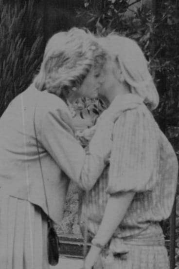 Princess Diana gives Lady Dale 'Kanga' Tryon, a farewell kiss after lunch to prove there was no rift with the Australian who was once a confidante of Prince Charles, 1986.