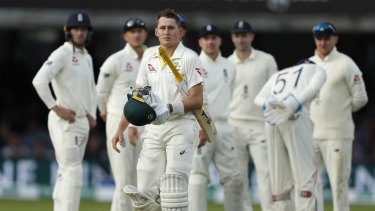 Australia's Marnus Labuschagne walks off the pitch after being given out caught by Joe Root off the bowling of Jack Leach.
