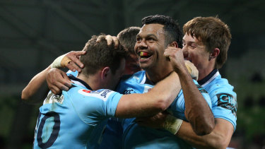 Pumped: Kurtley Beale celebrates a Waratahs win over the Rebels last year in Melbourne.