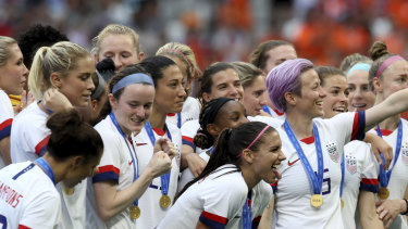 Invitation retracted?: Megan Rapinoe, centre, celebrates the United States' victory with her teammates after the Women's World Cup soccer final  against the Netherlands at the Stade de Lyon.