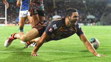 Greg Inglis celebrates with a goanna crawl after scoring a try.