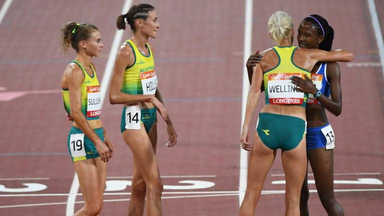 Memorable: Australian athletes wait at the finish line to embrace Lesotho's last-place finisher Lineo Chaka.