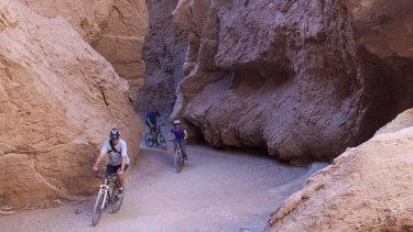 Little margin for error: mountain-biking through Devil's Throat gorge in Chile's Atacama Desert.