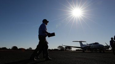 Prime Minister Scott Morrison prepares to board his plane following a regional drought tour at Quilpie in Queensland.