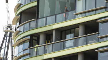 Tradesmen working on the Opal Tower at Sydney Olympic Park