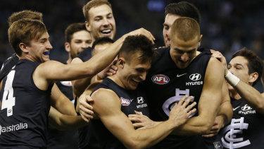 Carlton celebrate debutante Josh Deluca's goal on their way to a 24-point win against Gold Coast.