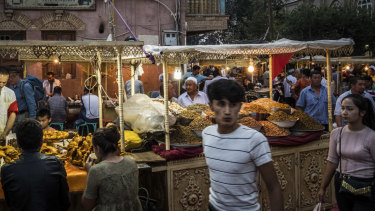 A market in Kashgar, a city in the Xinjiang region of China. Uighurs are under constant surveillance wherever they go in Xinjiang.