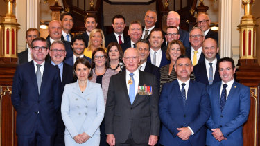 NSW Premier Gladys Berejiklian and her new 24-member ministry pose with NSW Governor David Hurley at Government House in Sydney.