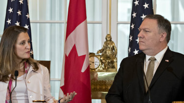 Chrystia Freeland, Canada's minister of foreign affairs, speaks as Mike Pompeo, US secretary of state, right, listens.