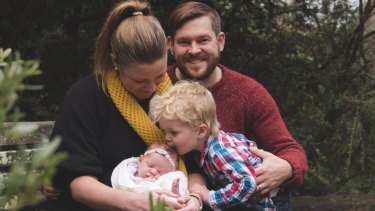 Katie Woodward and her husband Blake Woodward with baby Michaela and Samuel. Mr Woodward took parental leave when his wife returned to work.