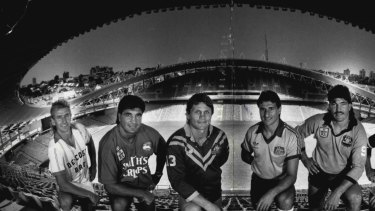 The players to play the new sports ground this year, representing their teams. From left, John Kosmina, Sydney Olympic, Soccer; Mario Fenech, South Sydney Rugby League; Wayne Pearce, Australia, Rugby League; Charlie Yankos, Australia Socceroos; Les Davidson, NSW Rugby League and Garry Worth, Eastern Suburbs Rugby League, January 07, 1988.