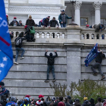 Trump supporters storm the US Capitol building in Washington, DC on January 6.