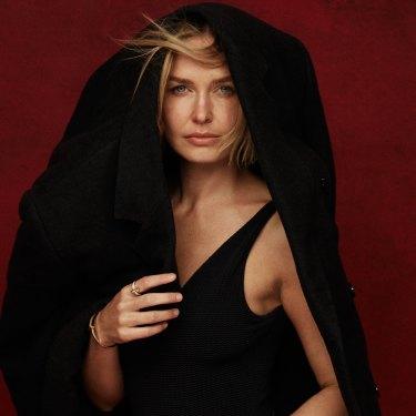 "Lara wears Esse Studios coat, Seafolly ""Seadive"" swimsuit. All jewellery by Tiffany & Co (worn throughout)."