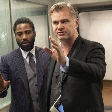Christopher Nolan, right, directs John David Washington on the set of Tenet.