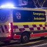 An ambulance races down Oxford Street.