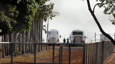 Buses ferry passengers from a flight from India to Howard Springs Quarantine Facility.