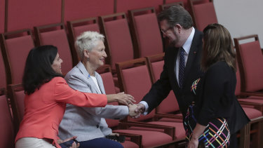 Derryn Hinch shakes hands with crossbench MPs Julia Banks and Kerryn Phelps in the Senate on Wednesday.