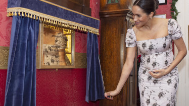 Meghan, pictured during a charity visit in London, has been criticised online for cradling her baby bump.