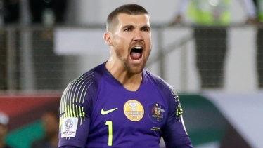 Hear me roar: Mathew Ryan pumps himself up after saving a penalty in Australia's shootout win over Uzbekistan.