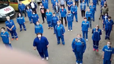Medical workers record a video appeal to Russian President Vladimir Putin in Armavir, Russia.
