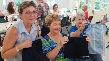 Janelle Downer and the Reef Sisters at the Cairns branch of the Australian Sewing Guild working to create outfits for the Uniforms 4 Kids project.