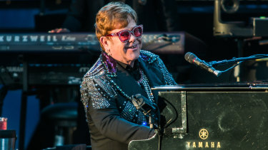 Elton John entertains the crowd with songs from his extensive back catalogue.