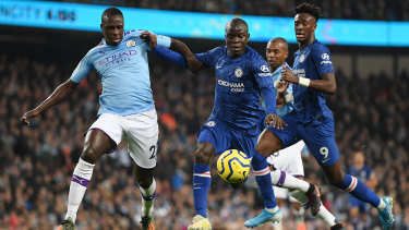 N'Golo Kante scores Chelsea's first goal during their clash with Manchester City at Etihad Stadium.