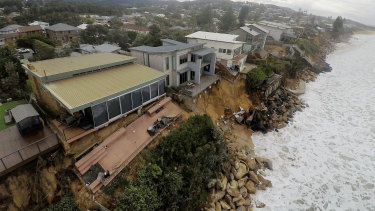Coastal erosion is seen from the air over Ocean View Drive at Wamberal on Saturday.