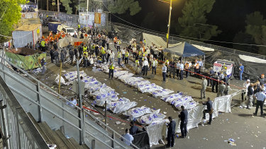 Israeli security officials and rescuers oversee the bodies of victims who died during a stampede at Mount Meron in northern Israel on Friday.