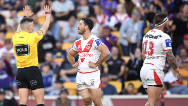 Josh McGuire of the Dragons is sin-binned for a high shot on Justin Olam.