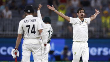 Starc appeals for the wicket of Watling.