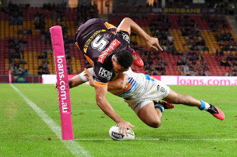 Xavier Coates goes over the line for a try that was later disallowed.