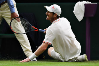 Andy Murray slips on day three at the All England club.