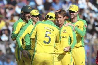 Adam Zampa (second right) celebrates dismissing Indian captain Virat Kohli.