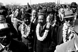 Martin Luther King Jr. walks across the Edmund Pettus Bridge in Selma, Alabama, on March 21, 1965,