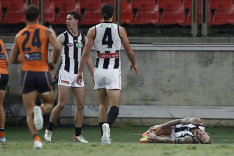A prone Jeremy Howe clutches at his knee after the collision with Jacob Hopper.