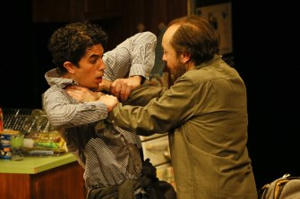 Steve Mouzakis and Karl Richmond wrestle in MTC's The Lifespan of a Fact.