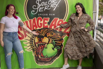 Besties Amanda Carn and Chanel Gellin celebrated 30 years of friendship with matching swallow tattoos at the Sailor Jerry 'savage apple' party.