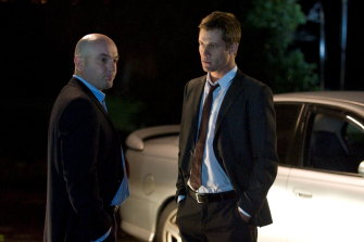 Scott McGregor (right) plays a police officer in 'Neighbours'.
