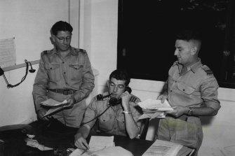 Flt. Lt. P. Lane (Brisbane) equipment officer, Wing Commander J. F. Lush (Melbourne) temporary Commander 90 Wing, and Squadron Leader G. Moodie (Melbourne), senior administration officer, at 90 Wing Headquarters, Malaya. December 5, 1950.