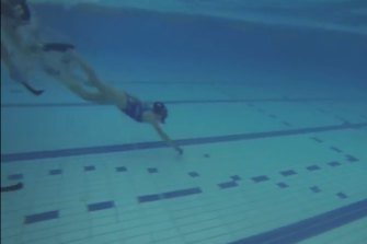 Ms Fowler, pictured playing underwater hockey, spends a lot of time in the water.