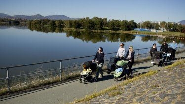Mums and dads walking around Lake Tuggeranong.