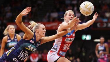 Natalie Haythornthwaite beats Renae Ingles to the ball.