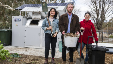 Events and projects manager Gaby Ho, director Ryan Lungu, garden coordinator Karina Bontes next to their new public composter at the Canberra Environment Centre.