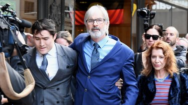 John Jarratt (centre) walks from court with his wife and lawyer after he was found not guilty of rape.