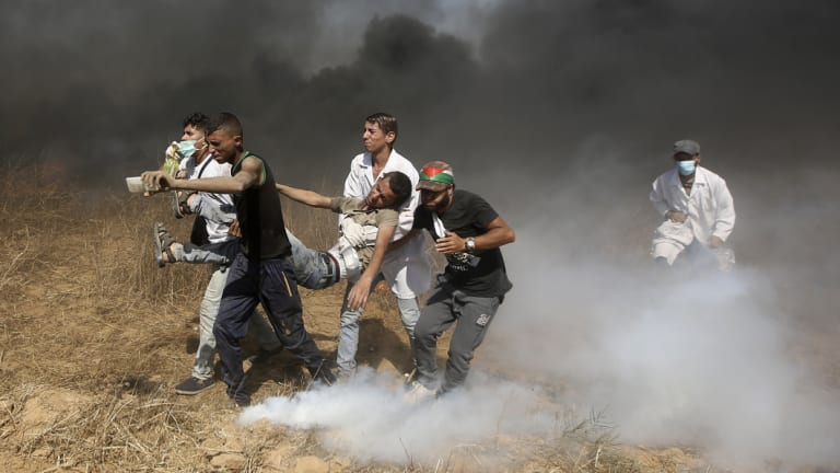 Palestinian medics evacuate a wounded youth near the Gaza Strip's border with Israel, during a protest east of Khan Younis, in the Gaza Strip in June.
