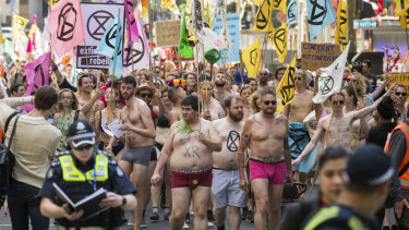Spring rebellion: Activists stripped to their underwear and marched through the city on Saturday.