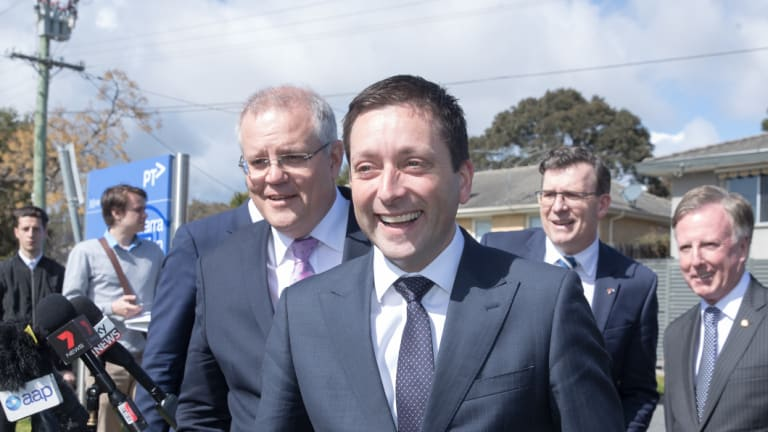 With state Opposition leader Matthew Guy at his shoulder, Mr Morrison reaffirmed the Coalition's $225 million commitment to electrify the Frankston line to Baxter.