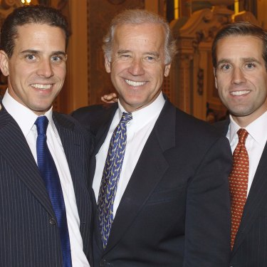 Hunter (at left) and Beau with their father in2004.