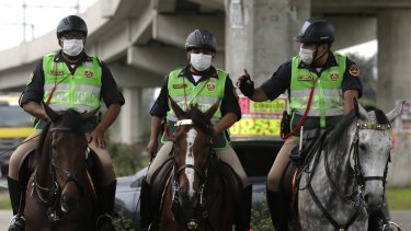 Horse-mounted police ride through the sewage-flooded streets as workers struggled to clean.